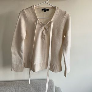 Cream sweater with tie detail in front
